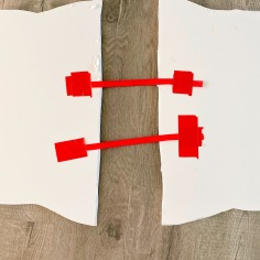red ribbon straps inside the board